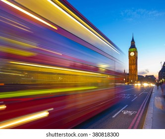 London, UK - Iconic Red Double Decker bus in motion at blue hour with the Big Ben at the background