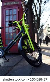 London \ UK Jan 01 2020 - London Freebike bike on London street in front of old style telephone box