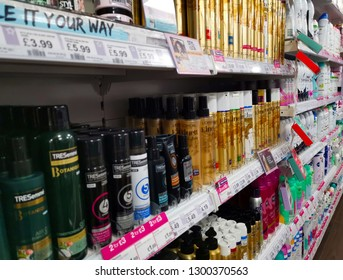 London, UK - Jan 21st 2019. Health and Beauty products on rows of shelves. In a health and beauty store.