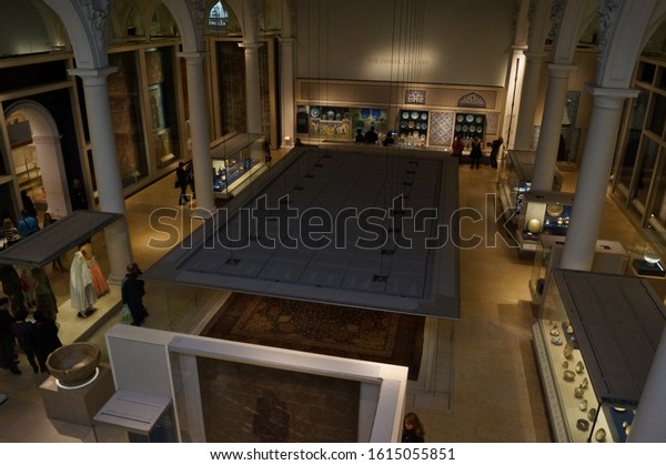 London, UK - Janaury 4 2014: interior of the Victoria and Albert Museum, the Jameel Gallery with the Ardabil Carpet