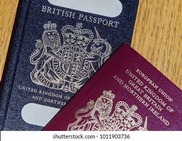 London, UK: January 04, 2018: An old blue British Passport under a new red European Union Passport. The British passport is due to return to use when Britain leaves the European Union in March 2019.