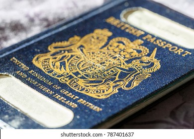 London, UK: January 04, 2018: An old blue British Passport with a gold insignia in selective focus. The British passport is due to return to use when Britain leaves the European Union in March 2019.