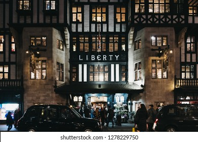 London, UK - January 05, 2019: People entering Liberty Department Store in Oxford Circus, London, in the evening. Opened in 1875, it is famous for luxury goods and classic Liberty designs.