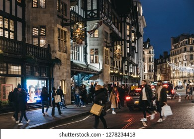 London, UK - January 05, 2019: People and cars in front of Liberty Department Store in Oxford Circus, London, in the evening. Opened in 1875, it is famous for luxury goods and classic Liberty designs.