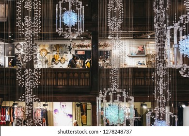 London, UK - January 05, 2019: People shopping inside Liberty Department Store in Oxford Circus, London. Opened in 1875, it is famous for luxury goods and classic Liberty designs.