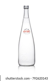 LONDON, UK - JANUARY 10, 2018:  Glass bottle of Pure Evian Natural Mineral Water on a white background. Made in France.