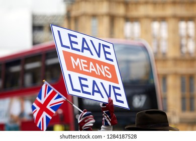 London, UK - January 14, 2019: A placard held by a Leave supporter outside Parliament at Westminster on the eve of a meaningful vote on the Brexit deal.