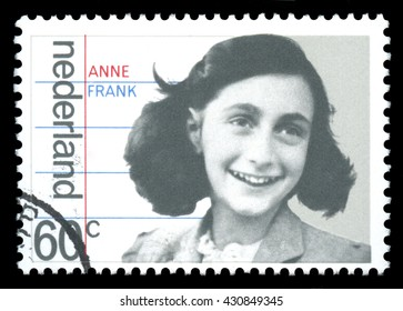 London, UK, January 15 2012 - Vintage 1980 Netherlands cancelled postage stamp  showing a portrait image of  Anne Frank a victim of the Holocaust, later to become famous for her diary