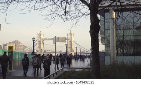 LONDON, UK. January 19, 2017. Tourists stroll along the promenade. Against the backdrop of Tower Bridge.