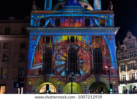 LONDON, UK - JANUARY 19 2018: Building at Piccadilly Circus illuminated at Lumiere London 2018.  The event is a popular annual attraction.