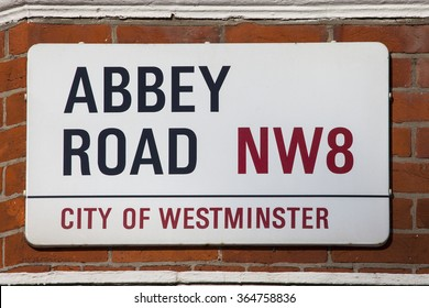 LONDON, UK - JANUARY 19TH 2016: A street sign for Abbey Road in London, on 19th January 2016.  The road is best known for being the home of the famous music recording studio and iconic zebra crossing.