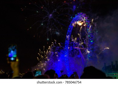 London, UK - January 1st 2018. Fireworks display at the London Eye in the British capital celebrates the end of 2017 and the arrival of the new year with large crowds gathering on Westminster Bridge.
