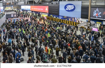 London, UK - January 20, 2015: People in front of time board in evening rush hour at Waterloo train station in the centre of the main concourse