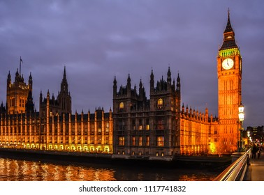 London, UK - January 20, 2015: View of the Palace of Westminster with Big Ben, Victoria and Central Towers in night illumination from the Westminster bridge.