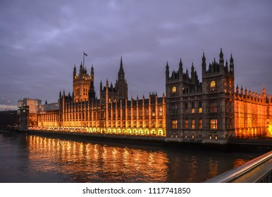 London, UK - January 20, 2015: View of the Palace of Westminster with Victoria and Central Towers in night illumination from the Westminster bridge.