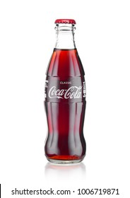 LONDON, UK - JANUARY 20, 2018: Cold glass bottle of Coca Cola drink on white background. The drink is produced and manufactured by The Coca-Cola Company.