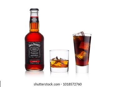 LONDON, UK - JANUARY 20, 2018: Bottle of Jack Daniel's and cola mixed with whiskey glass and cola on white background.