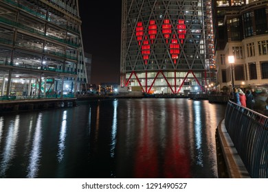 LONDON, UK - JANUARY 20, 2019:  Winter Lights Festival brings Canary Wharf to life after dark. It includes Two Hearts projection on Newfoundland Place by Stuart Langley.