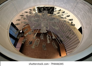 London UK, January 2018. Installation entitled 'Breathless' at Victoria and Albert Museum, London showing suspended squashed musical instruments.