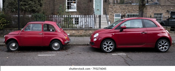 London UK, January 2018. Two red Fiat 500 cars parked on a residential street.