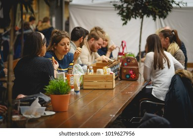 London, UK - January 2018. Young people chatting in a pub in Greenwich Market.