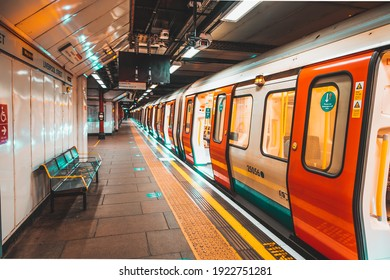 London UK January 2021 Underground Tube metro train stopped on a platform station in London, doors open with no people, UKs national covid lockdown