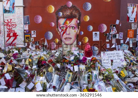 LONDON, UK - JANUARY 20TH 2016: A piece of graffiti of David Bowie as Ziggy Stardust in Brixton, London on 20th January 2016.  Since his death the mural has been the centre of a shrine in his memory.