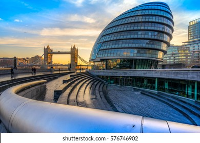 LONDON, UK - JANUARY 24, 2017: London City Hall Building and Tower Bridge . The City hall building designed by Norman Foster, has solar panels installed on the roof.