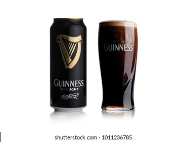 LONDON, UK - JANUARY 24, 2018: Aluminium can and glass of Guinness draught beer on white background. Guinness beer has been produced since 1759 in Dublin, Ireland.