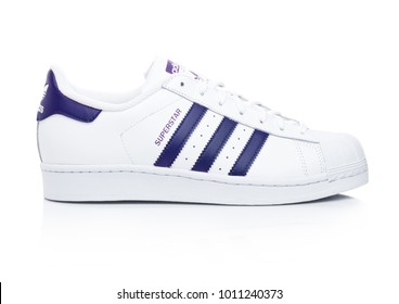 LONDON, UK - JANUARY 24, 2018: Adidas Originals Superstar blue shoes on  white