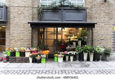 LONDON, UK - January 25: Small local flower shop on South Bank of Thames river in London, UK - January 25, 2013; Local flower shop in central London with beautiful outside display.