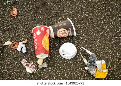 LONDON, UK - JANUARY 28, 2016:  Overhead view of discarded coffee cups a bag and some food left on a pavement. Includes cups from Costa and Patisserie Valerie.