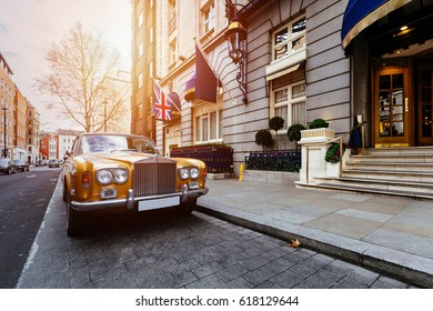 LONDON, UK - JANUARY 28, 2017: Front view of Exclusive Luxury Rolls-Royce car limousine parked outside luxury hotel wedding vip event waiting for passenger.