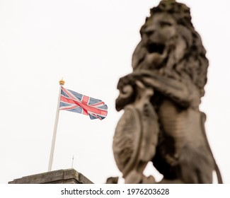 London, UK - January 29, 2017: A detail photo of the Victoria Memorial including a unicorn and lion statue outside of Buckingham Palace in London.