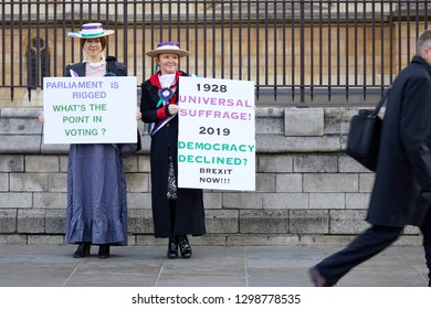 London, UK. - January 29, 2019: Leave campaigners dressed as Suffragettes stand outside Parliament on a crucial day for Brexit discussion inside the House of Commons.