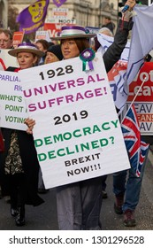 London, UK. - January 29, 2019: A campaigner marches past Parliament dressed as a suffragette protests against loss of democracy on a crucial day for Brexit discussion inside the House of Commons.