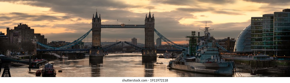 LONDON, UK - JANUARY 30, 2010: Panorama view of Tower Bridge, City Hall and HMS Belfast at Dawn