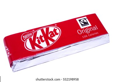 LONDON, UK - JANUARY 4TH 2017: An unopened Kit Kat chocolate bar manufactured by Nestle, pictured over a plain white background on 4th January 2017.