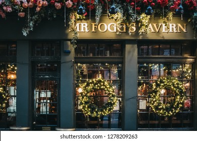 London, UK - January 5, 2019: Christmas decorations on Mr. Fogg's Tavern, old-style tavern themed around explorer Phileus Fogg, in Covent Garden, one of the most popular tourist areas in London.