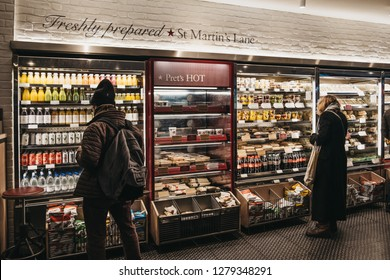 London, UK - January 5, 2019: People choosing food inside Pret a Manger, a popular international sandwich shop chain that is based in UK and has approximately 500 shops in nine countries.