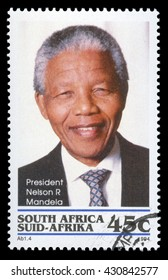 London, UK, January 7 2012 - Vintage 1994 Republic of South Africa cancelled postage stamp  showing a portrait image of  Nelson Mandela