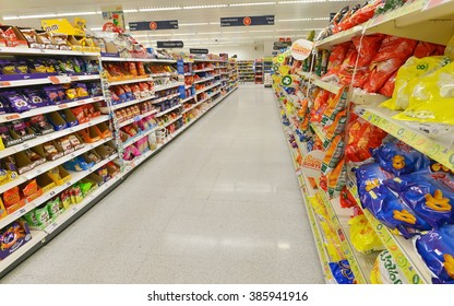 LONDON, UK - JUL 3, 2014: A general view of an aisle in a Sainsbury's supermarket. Sainsbury's is the UK's 2nd largest supermarket with a revenue of GBP 23 billion in 2013.