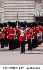 London, UK - JUL 5 : Guard Change Times at Buckingham Palace on Jul 5, 2011. The official start time for the ceremony is 11:30am. However, the guard with music start arriving at 11:15am