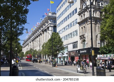 LONDON, UK - JULY 03, 2014: Oxford street shopping mail with famous fashion boutiques and super stors
