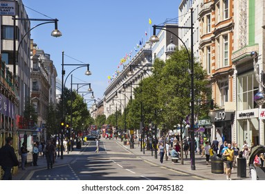 LONDON, UK - JULY 03, 2014: Oxford street shopping mail with famous fashion boutiques and super stores