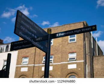 London, UK - July 07 2018: Tourist sign on the street, indicating directions to different places in Shoreditch area.