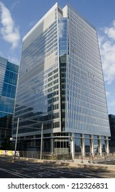 LONDON, UK  JULY 1, 2014:  New office block 25, Churchill Place in  Canary Wharf, London Docklands.  The new building will be home to the European Medicines Agency and accountants Ernst & Young.