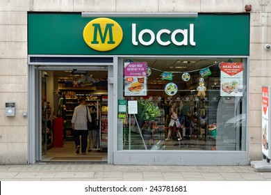 LONDON, UK - JULY 1, 2014: The exterior of a Morroson local supermarket on a street in central London. Morrison is the fourth largest chain of supermarkets in the UK with headquarters in Bradford.