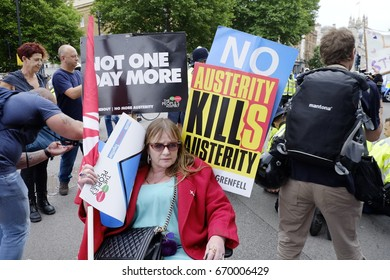 "London, UK - July 1, 2017:  An activist in front of the gates of Downing Street campaigning against the Conservative government as part of a ""Not One Day More"" protest on July 1 in London, England."
