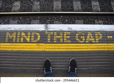 LONDON, UK - JULY 10TH 2015: Mind the Gap painted on a tube platform in central London, on 10th July 2015.